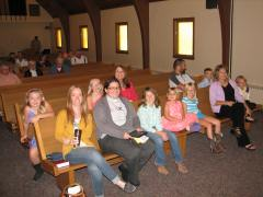 pastor kara surrounded by friends (highly unusual in the front pew)